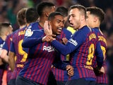 Malcom is congratulated by Barcelona teammate Arthur after equalising against Real Madrid on February 6, 2019