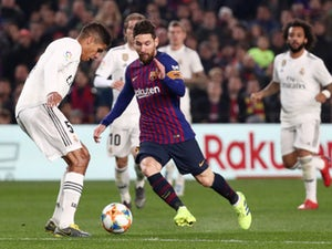 Barcelona forward Lionel Messi is crowded out by Real Madrid players on February 6, 2019