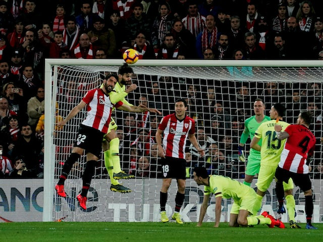 Barcelona's Gerard Pique challenges Athletic Bilbao's Raul Garcia during their La Liga clash on February 10, 2019
