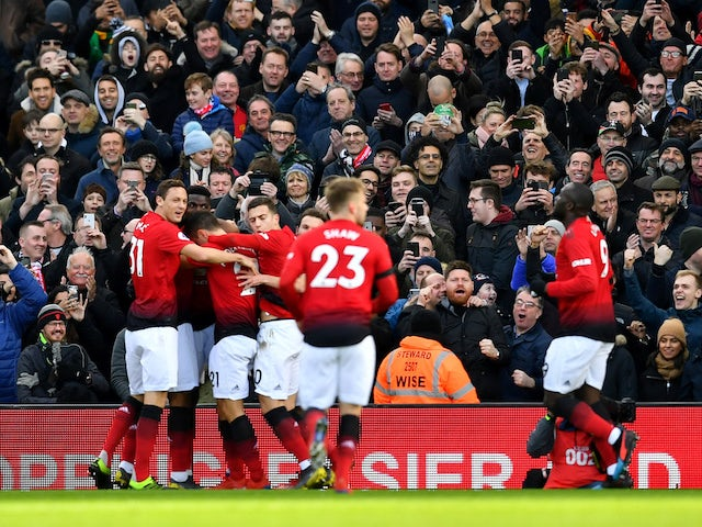 Manchester United players celebrate the opening goal against Fulham on February 9, 2019