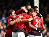 Manchester United players celebrate Paul Pogba's second goal against Fulham on February 9, 2019