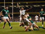England's Henry Slade scores a try during the Six Nations clash with Ireland on February 2, 2019