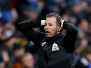 Huddersfield Town manager Jan Siewert reacts emotionally during their Premier League match with Arsenal on February 9, 2019.