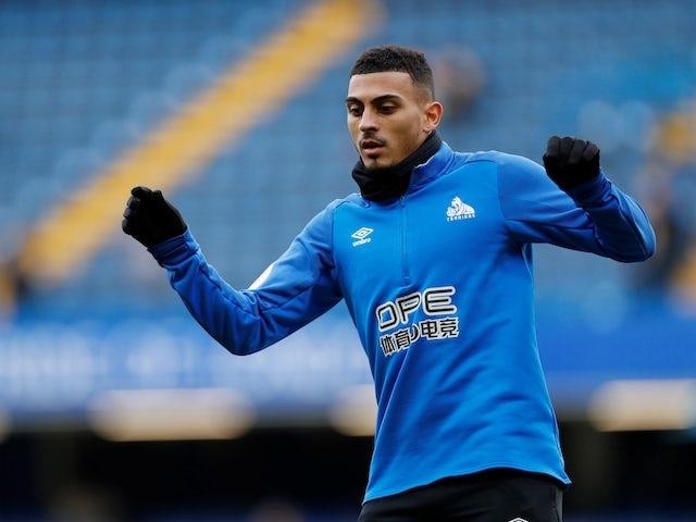 Karlan Grant claiming Huddersfield's goal against Arsenal