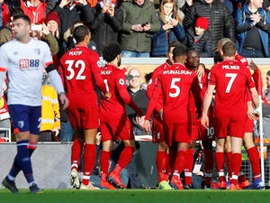 Liverpool cruise past Bournemouth to regain top spot