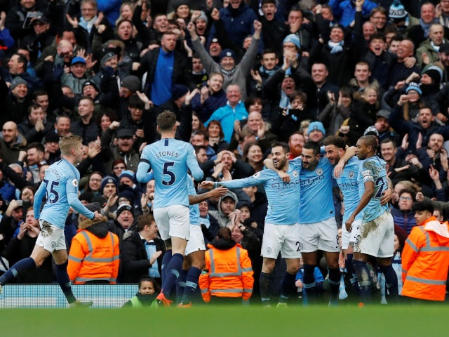 Ilkay Gundogan is mobbed by his Manchester City teammates after scoring his side's fourth goal against Chelsea on February 10, 2019