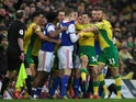 Norwich and Ipswich players clash during their derby on February 10, 2019