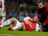 Arsenal defender Shkodran Mustafi grimaces in pain during his side's Premier League clash with Manchester City on February 3, 2019