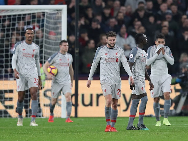 Liverpool players react to conceding against West Ham United on February 4, 2019