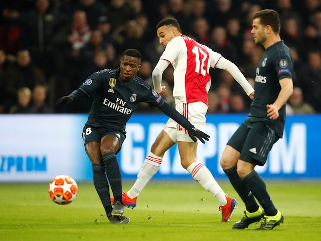 Ajax's Noussair Mazraoui in action with Real Madrid pair Vinicius Junior and Nacho in the Champions League on February 13, 2019