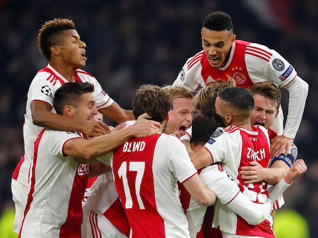 Ajax players celebrate a 'goal' - disallowed by VAR - against Real Madrid in the Champions League on February 13, 2019