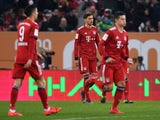 Bayern Munich's players look dejected after scoring an own goal against Augsburg on February 15, 2019