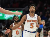 New York Knicks guard Dennis Smith Jr. (5) reacts after a Knicks basket against the Atlanta Hawks during the second half at State Farm Arena on February 15, 2019