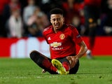 Manchester United midfielder Jesse Lingard goes down injured during the Champions League clash with PSG on February 12, 2019
