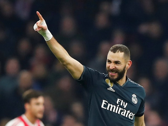 Real Madrid forward Karim Benzema celebrates scoring against Ajax in the Champions League on February 13, 2019