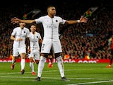Paris Saint-Germain attacker Kylian Mbappe celebrates scoring against Manchester United on February 12, 2019