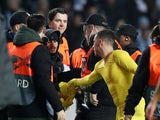 Chelsea's Eden Hazard gives a pitch invader his shirt after the Europa League clash with Malmo on February 14, 2019