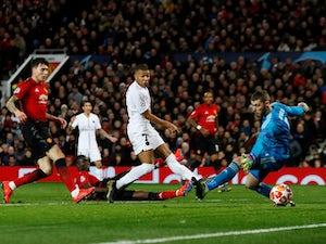 Paris Saint-Germain forward Kylian Mbappe scores against Manchester United on February 12, 2019