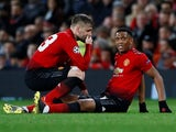 Manchester United winger Anthony Martial goes down injured during the Champions League clash with PSG on February 12, 2019