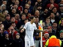 Paris Saint-Germain midfielder Angel Di Maria has a bottle thrown at him during the Champions League cash with Manchester United on February 12, 2019