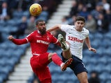 Preston North End's Andrew Hughes in action with Nottingham Forest's Lewis Grabban on February 16, 2019