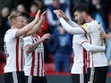 Sheffield United players celebrate after scoring against Reading on February 16, 2019