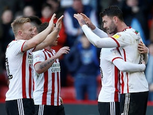 Sheffield United go second with thumping win over Reading