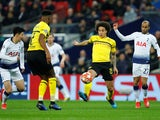Borussia Dortmund's Axel Witsel in action with Tottenham's Son Heung-min and Lucas Moura on February 13, 2019