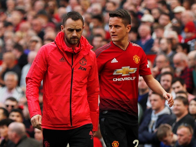 Manchester United midfielder Ander Herrera is forced off with an injury against Liverpool on February 24, 2019