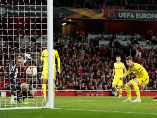 BATE Borisov's Zakhar Volkov scores an own goal versus Arsenal in the Europa League on February 21, 2019.
