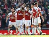Arsenal's Henrikh Mkhitaryan celebrates scoring their second goal with teammates against Southampton on February 24, 2019