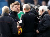 Tottenham Hotspur manager Mauricio Pochettino confronts referee Mike Dean after his side's defeat to Burnley on February 23, 2019