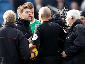Pochettino blames disappointment of defeat for heated referee exchange