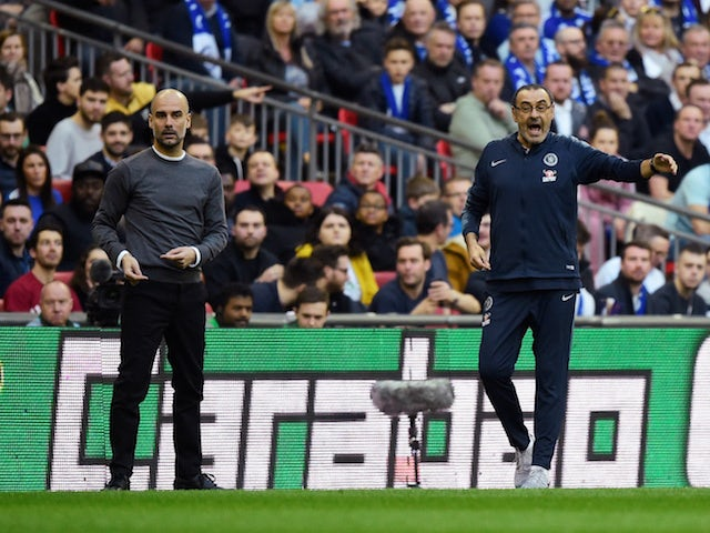 Chelsea manager Maurizio Sarri and Manchester City counterpart Pep Guardiola watch on during the EFL Cup final on February 24, 2019