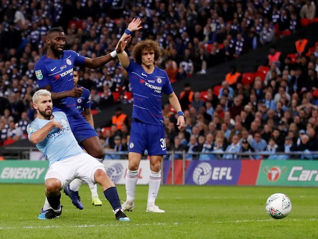 Manchester City striker Sergio Aguero scores from an offside position during the EFL Cup final against Chelsea on February 24, 2019