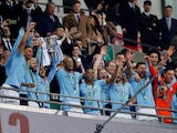 Manchester City players celebrate winning the EFL Cup final against Chelsea on February 24, 2019
