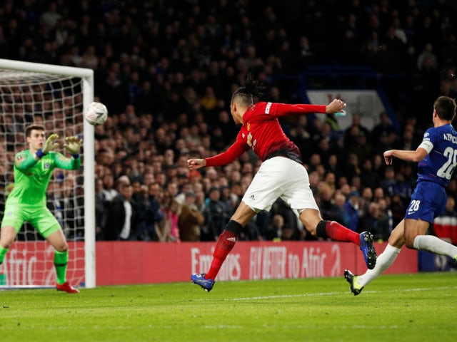 Chris Smalling has a header kept out by Kepa Arrizabalaga during the FA Cup tie between Chelsea and Manchester United on February 18, 2019