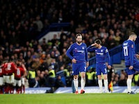 Chelsea's players look dejected as Manchester United celebrate their opening goal on February 18, 2019