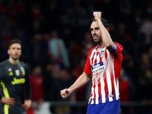 Diego Godin celebrates scoring for Atletico Madrid on February 20, 2019