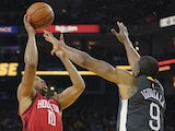 Houston Rockets guard Eric Gordon (10) shoots the basketball against Golden State Warriors guard Andre Iguodala (9) during the second quarter at Oracle Arena on February 24, 2019