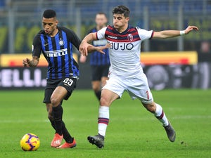 Bologna's Riccardo Orsolini in action with Inter Milan's Dalbert Henrique in Serie A on February 3, 2019