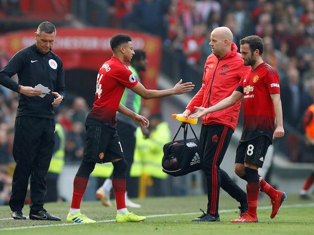 Manchester United's Juan Mata is substituted for Jesse Lingard in the Premier League match against Liverpool on February 24, 2019.