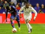 Real Madrid's Vinicius Junior in action with Levante's Moses Simon in La Liga on February 24, 2019