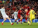 Liverpool goalkeeper Alisson saves from Joel Matip during the Champions League clash with Bayern Munich on February 19, 2019