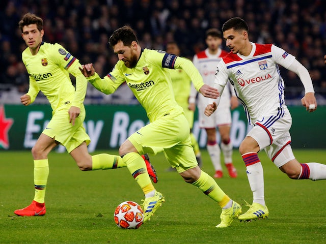 Barcelona's Lionel Messi runs clear against Lyon in their Champions League clash on February 19, 2019