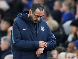 Under-fire Chelsea manager Maurizio Sarri checks his watch on February 21, 2019