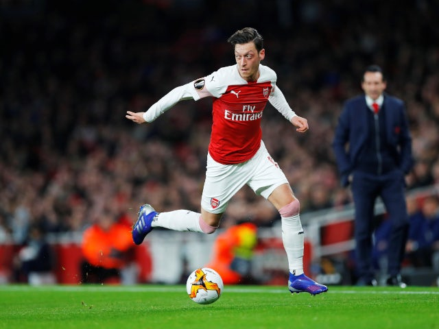 Mesut Ozil receives the  ball as Arsenal play BATE Borisov in the Europa League on February 21, 2019.