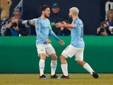 Sergio Aguero and David Silva celebrate Manchester City's opening goal against Schalke 04 in the Champions League on February 20, 2019.