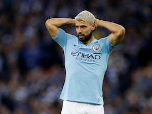 Manchester City striker Sergio Aguero jokes around in training