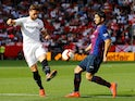 Barcelona's Luis Suarez in action with Sevilla's Sergi Gomez during their La Liga clash on February 23, 2019